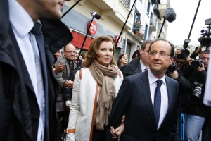 Francois Hollande, Socialist Party candidate for the 2012 French presidential election and companion Valerie Trierweiler leave the poling station casting his ballot in the second round of 2012 French presidential election inTulle